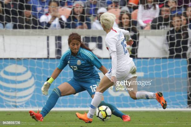 Mexico Goalkeeper Cecilia Santiago fights for the ball with Megan Rapinoe of United States during the match between Mexico and United States at BBVA...