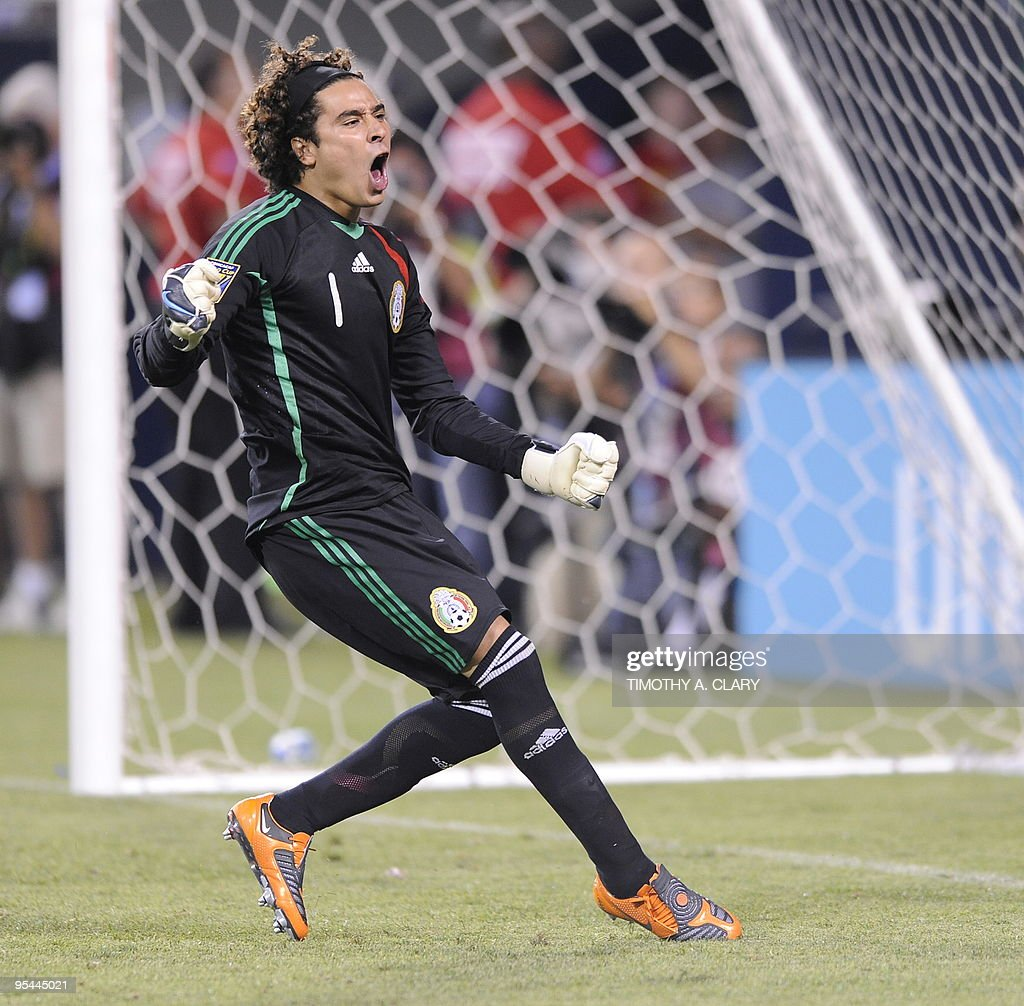 Mexico goalkeeper Guillermo Ochoa stops the penalty kick of Costa Rica's Froylan Ledezma in the shootout during their CONCACAF Gold Cup semi-final soccer match July 21, 2009 at Soldier Field in Chicago, Illinois. Mexico won 6-4.