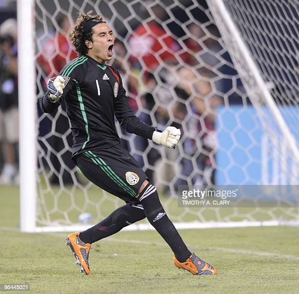 Mexico goalkeeper Guillermo Ochoa stops the penalty kick of Costa Rica's Froylan Ledezma in the shootout during their CONCACAF Gold Cup semifinal...
