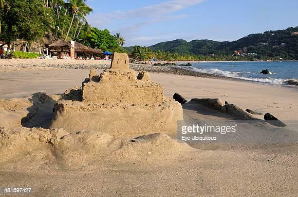 Mexico Guerrero Zihuatanejo Playa la Ropa sandcastle on the beach