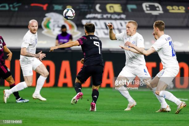 Mexico Henry Martin and Iceland Hjortur Hermannsson chase the ball during the game between Mexico and Iceland on May 29, 2021 at AT&T Stadium in...