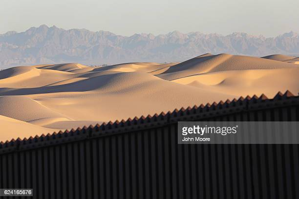 Mexico is seen over the USMexico border fence at the Imperial Sand Dunes on November 17 2016 near Felicity California The 15foot border fence there...