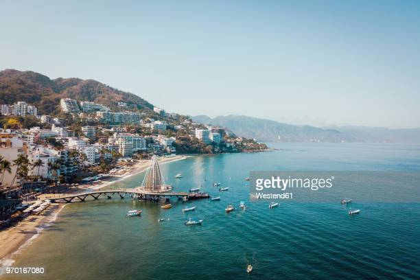 mexico, jalisco, aerial view of playa los muertos, beach and pier in puerto vallarta - mexiko stock-fotos und bilder