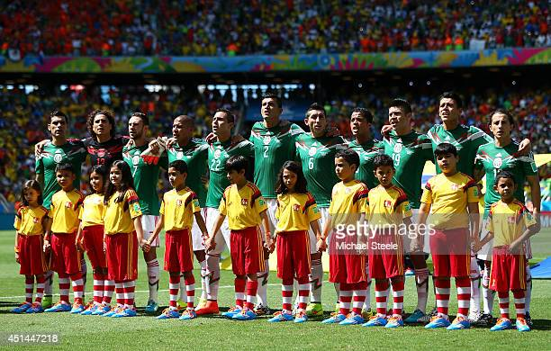 Mexico line up for the National Anthem prior to the 2014 FIFA World Cup Brazil Round of 16 match between Netherlands and Mexico at Castelao on June...