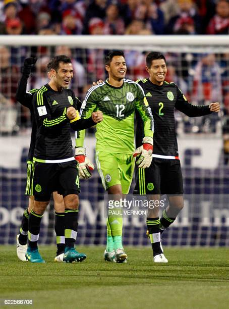 Mexico men's national team defender Rafael Marquez goal keeper Alfredo Talavera and Hugo Ayala celebrate the team's 21 win against the US men's...