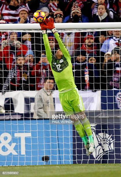 Mexico men's national team goal keeper Alfredo Talavera makes a stop against the US men's national team during the 2018 FIFA World Cup qualifying...