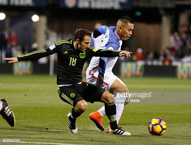 Mexico Men's National team midfielder Andres Guardado left works against US Men's National team forward Bobby Wood during the 2018 FIFA World Cup...