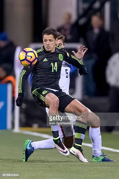 Mexico Men's National Team player Javier Hernandez battles with United States Men's National Team player Matt Besler to control a loose ball from the...