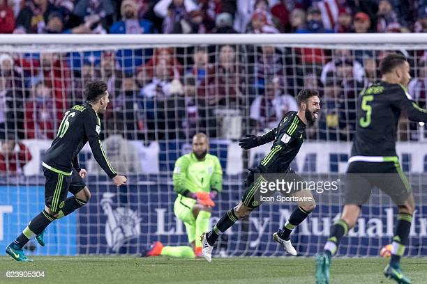 Mexico Men's National Team player Miguel Layun celebrates with teammates after scoring a goal past United States Men's National Team player Tim...