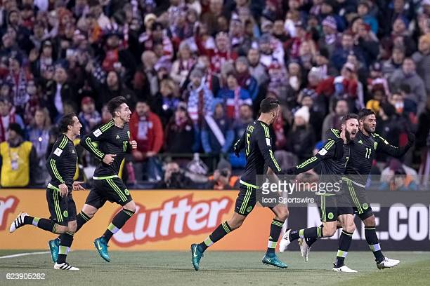 Mexico Men's National Team player Miguel Layun celebrates with Mexico Men's National Team player Carlos Vela and teammates after scoring a goal past...