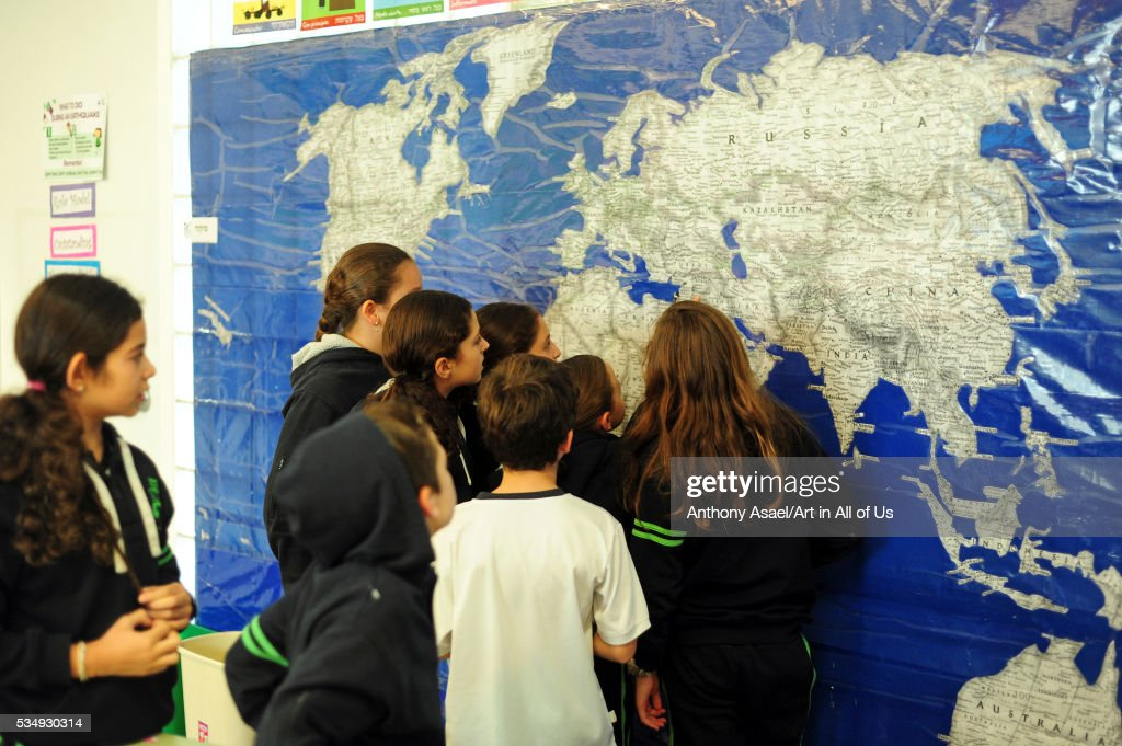 mexico mexico city children looking at large wall world map