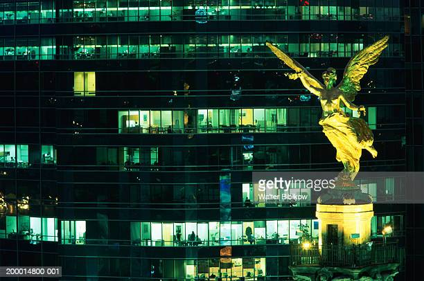 Mexico, Mexico city, 'El Angel' monument and offices at night