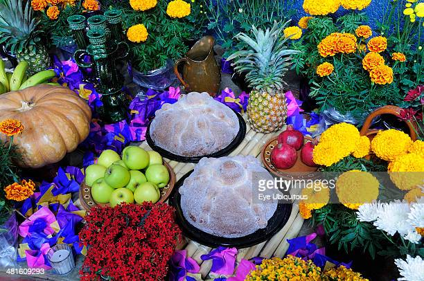 Mexico Michoacan Patzcuaro Altar with display of food and flowers including marigolds for Dia de los Muertos or Day of the Dead festivities