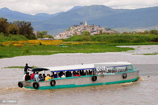 Mexico Michoacan Patzcuaro Crowded passenger boat on Lago Patzcuaro with Isla Janitzio beyond