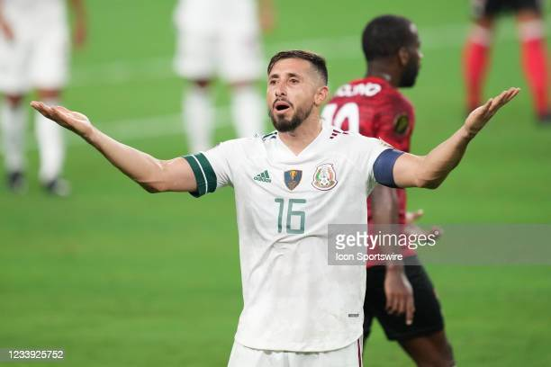 Mexico midfielder Hector Herrera reacts as play against Trinidad and Tobago was suspended due to fan behavior in the second half of the 2021 CONCACAF...