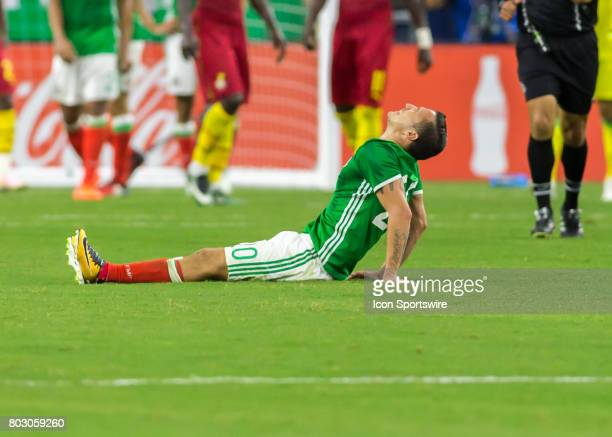 Mexico midfielder Jesús Dueñas goes to the ground in pain during the Mexico vs Ghana friendly soccer match at on June 28 2017 at NRG Stadium in...