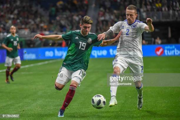 Mexico midfielder Jonathan Gonzalez and Bosnia and Herzegovina defender Almir Bekic chase down a loose ball during second half action during the...