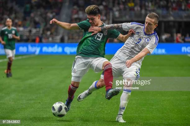 Mexico midfielder Jonathan Gonzalez and Bosnia and Herzegovina defender Almir Bekic fight for a loose ball during second half action during the...