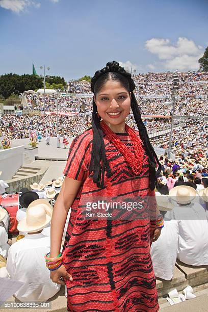 mexico, oaxaca, guelaguetza festival, woman wearing traditional dress standing on tribunes, portrait - guelaguetza photos et images de collection