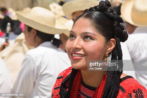mexico, oaxaca, guelaguetza festival, woman wearing traditional dress sitting on tribunes - guelaguetza stock photos and pictures