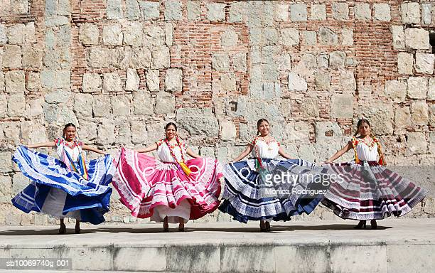mexico, oaxaca, istmo, four women in traditional dresses dancing - traditional dancing stock photos and pictures