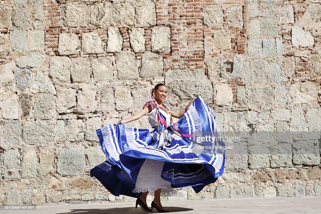 Mexico, Oaxaca, Istmo, woman in traditional dress dancing : Stock Photo