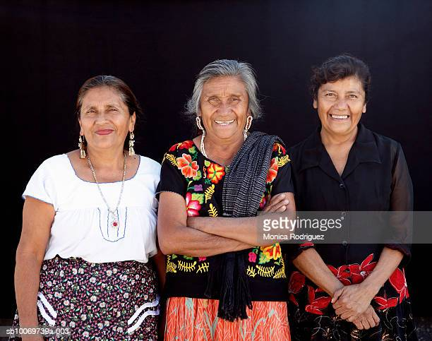 Mexico, Oaxaca, Ocotlan, portrait of three sisters, folk artists