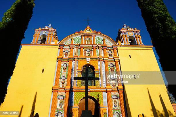 Mexico, Oaxaca, Santa Ana Zegache, Low angle view of yellow ornate church