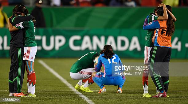 Mexico players are distraught after losing the FIFA U20 Women's World Cup Canada 2014 Group D match between Korea Republic and Mexico at the National...
