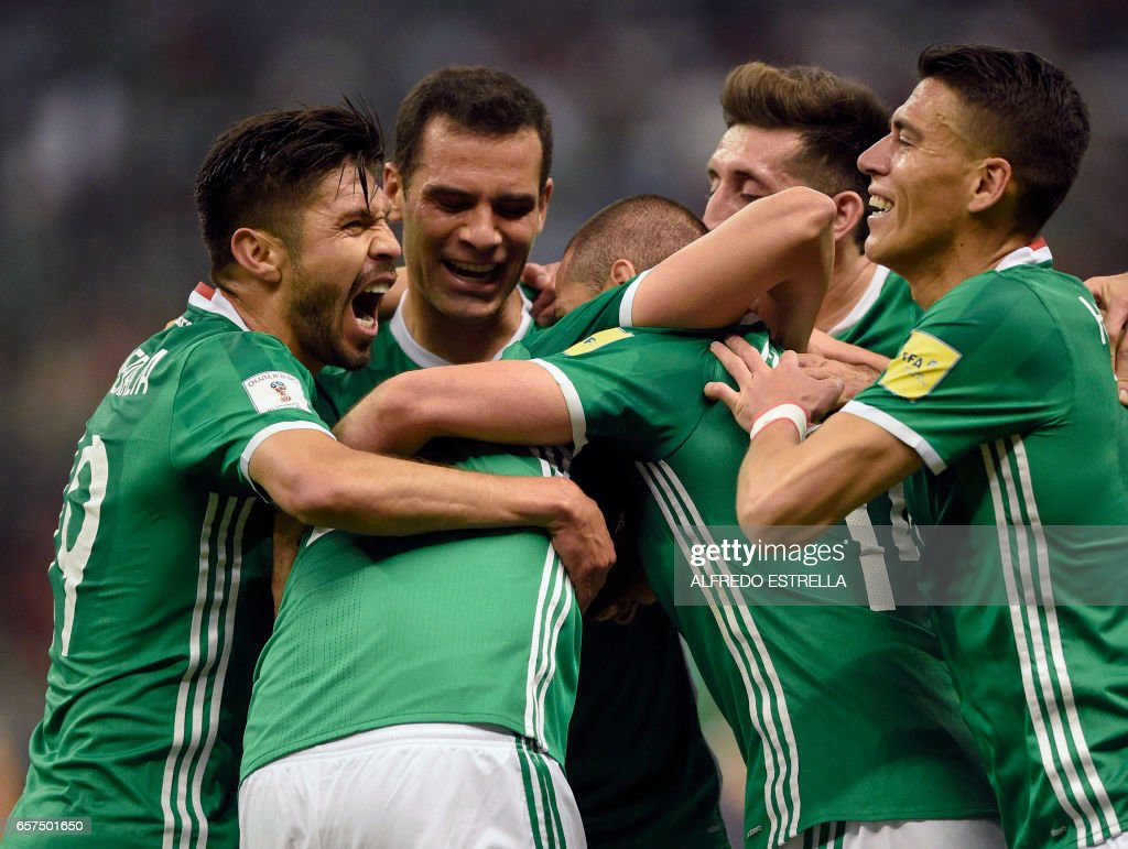 Mexico players celebrate a goal against Costa Rica during their 2018 FIFA World Cup qualifier football match in Mexico City on March 24, 2017. /