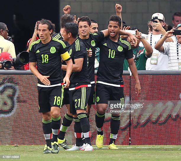 Mexico players celebrate after a goal against Costa Rica in an international friendly at the Orlando Citrus Bowl on Saturday June 27 in Orlando Fla...