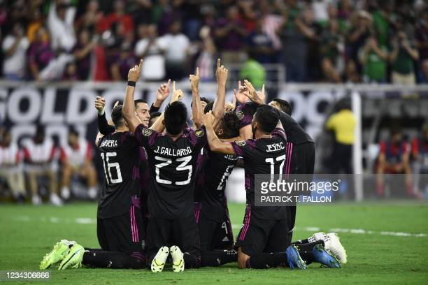 Mexico players celebrate after scoring a goal during the Concacaf Gold Cup football match semifinal between Mexico and Canada at NRG stadium in...