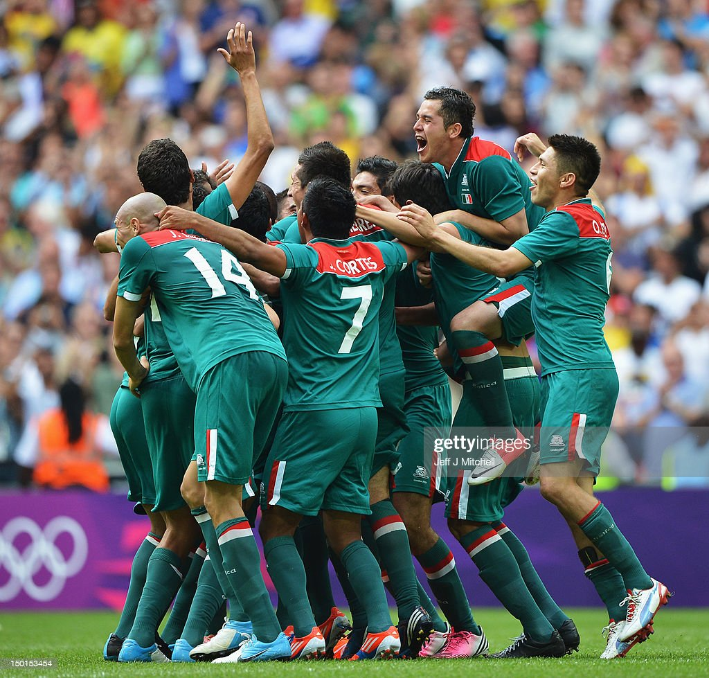 Mexico players celebrate after winning gold in the Men's Football Final between Brazil and Mexico on Day 15 of the London 2012 Olympic Games at Wembley Stadium on August 11, 2012 in London, England.