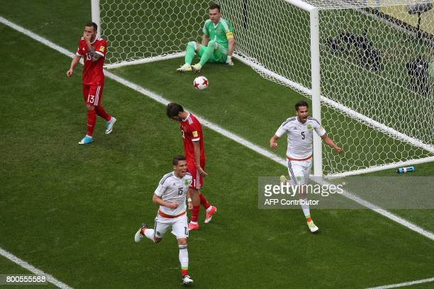 Mexico players celebrate their first goal during the 2017 Confederations Cup group A football match between Mexico and Russia at the Kazan Arena...