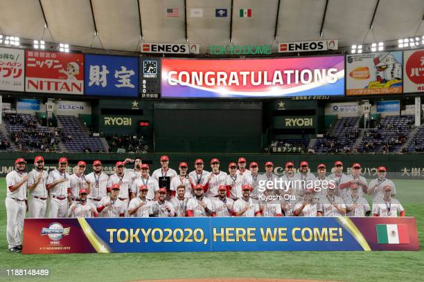 Mexico players celebrate their victory and qualification for the Tokyo 2020 Olympic Games after the WBSC Premier 12 Bronze Medal final game between...