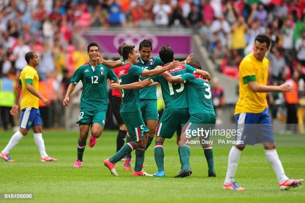 Mexico players celebrate their victory over Brazil during the Football Men's Gold Medal Match between Mexico and Brazil at Wembley Stadium London