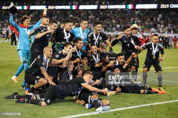 Mexico players celebrate with the CONCACAF Gold Cup trophy after beating USA 1-0 in the 2019 CONCACAF Gold Cup Final between Mexico and United States...