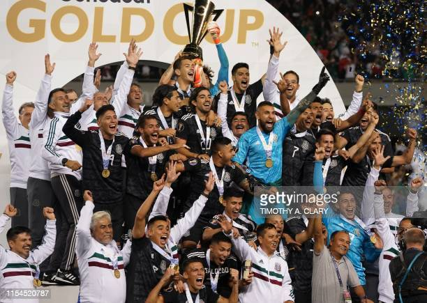 Mexico players celebrate with the Gold Cup after beating the US during the 2019 Concacaf Gold Cup final football match between USA and Mexico on July...