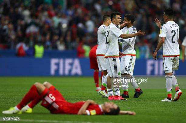 Mexico players celerbate their 21 victory while Viktor Vasin of Russia shows dejection after the FIFA Confederations Cup Russia 2017 Group A match...