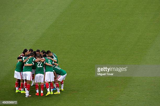 Mexico players embrace before the 2014 FIFA World Cup Brazil Group A match between Mexico and Cameroon at Estadio das Dunas on June 13 2014 in Natal...