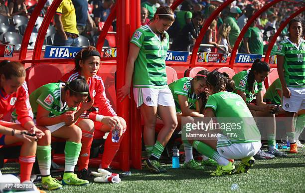 Mexico players look on after losing to France in the FIFA Women's World Cup 2015 Group F match between Mexico and France at Lansdowne Stadium on June...