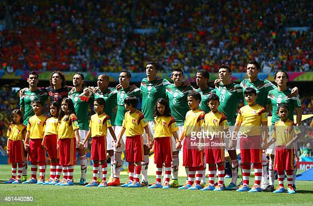 Mexico players sing the National Anthem prior to the 2014 FIFA World Cup Brazil Round of 16 match between Netherlands and Mexico at Castelao on June...