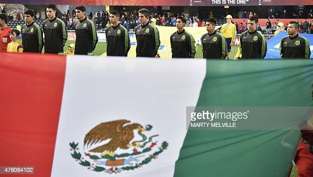 Mexico players stand for the national anthems before the start of the FIFA Under20 World Cup football match between Mexico and Serbia in Dunedin on...
