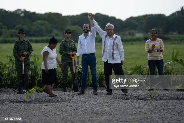 Mexico President Manuel Lopez Obrador and El Salvador President Nayib Bukele wave during a joint press conference launching the Planting Life...