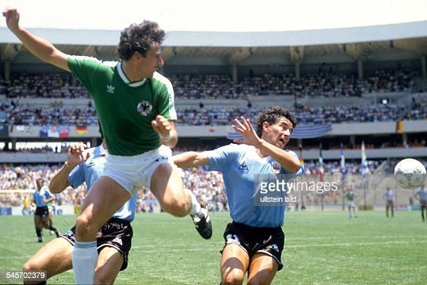 Mexico Queretaro 1986 FIFA World Cup Mexico Group E Uruguay v Germany 11 Klaus Allofs battling for the ball with Sergio Santin