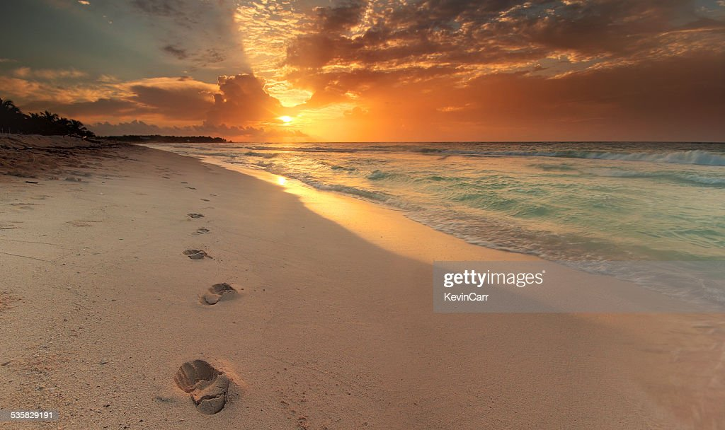 Mexico, Riviera Maya, Akumal beach, View along coastline with footprints in sand at sunrise : Stock Photo