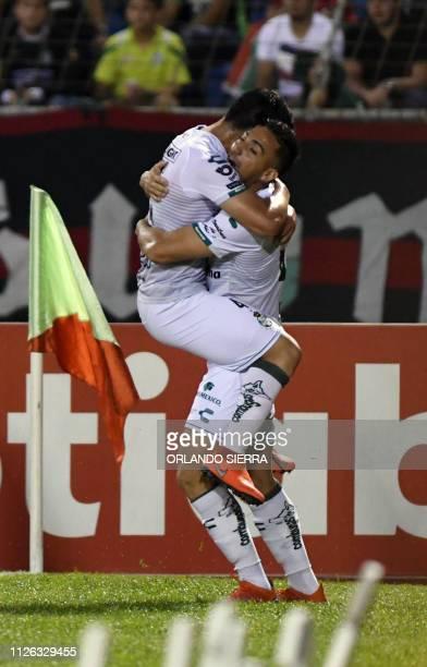 Mexico' s Santos Laguna Javier Correa celebrates with teammates after scoring against Honduras' Marathon during their Concacaf Champions League...