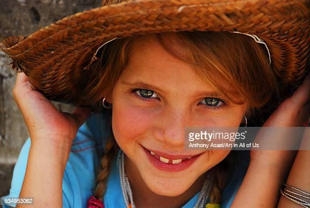 Mexico San Miguel de Allende closeup portrait of a cute little girl smiling with mexican hat