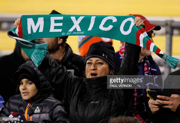 Mexico soccer fans cheer during the second half of a 2018 FIFA World Cup qualifying match between the Mexico men's national team and the US men's...
