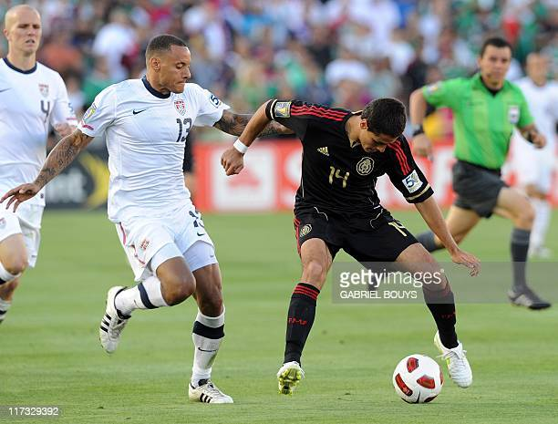 Mexico striker Javier Hernandez outpasses US defender Jermaine Jones during the CONCACAF 2011 Gold Cup final match United States against Mexico on...